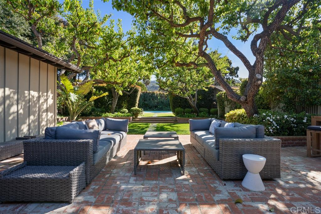 This modernized single-level sits on over 1/2 an acre that is immensely private yet adjacent to the heart of the Shores village. A classic style entry leads you through spacious rooms to an expansive backyard with brick patio, lawn and pool lined with mature trees. Offering 5BRs/3.5BAs, ample parking and oversized rooms, this is the ideal property for a family compound or secluded estate to enjoy as is or personalize! Virtual tour Link: https://my.matterport.com/show/?m=RQbc7Am33rt&mls=1