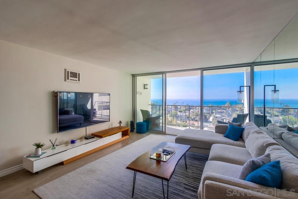 Watch the waves crashing, the sun set on the water, and the lights twinkle over Pacific Beach from this rarely available 9th floor direct West facing corner condo. Tastefully remodeled with sit-down panoramic views of the ocean, Mission Bay, and city views from pacific beach through mission beach, ocean beach and point loma. Light and bright open floor plan, with floor to ceiling glass walls in the living area and master bedroom. Underground parking space. Don't miss this opportunity!.