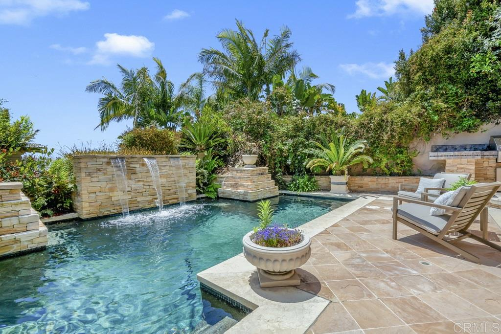 Wonderfully private 4 Bedroom, 5,000sqft view laden La Jolla Retreat.  Start and finish each day with expansive city, bay and ocean views that span over 200 degrees.  Southern exposure perfectly complements a resort like pool/spa area accented with mature landscaping once featured in a prominent architectural magazine.  Wow guests with an ideal venue to enjoy July 4th, regular Sea World fireworks and an incredible skyline including glistening city lights and regular activity in the sky and sea. (see supp)The thoughtful layout was designed to maximize views from virtually all rooms & view decks offer indoor/outdoor living. Chef grade kitchen, formal dining, oversized bonus room, billiards room, & enormous 4th bedroom that could easily be split, converted to a gym, the list goes on. Spa like master retreat with his and hers features, Jacuzzi, & steam shower. Fenced turf side yard features a putting green and offers a nice space for a dog run. Award winning schools, spectacular shopping, restaurants, and entertainment located moments away.