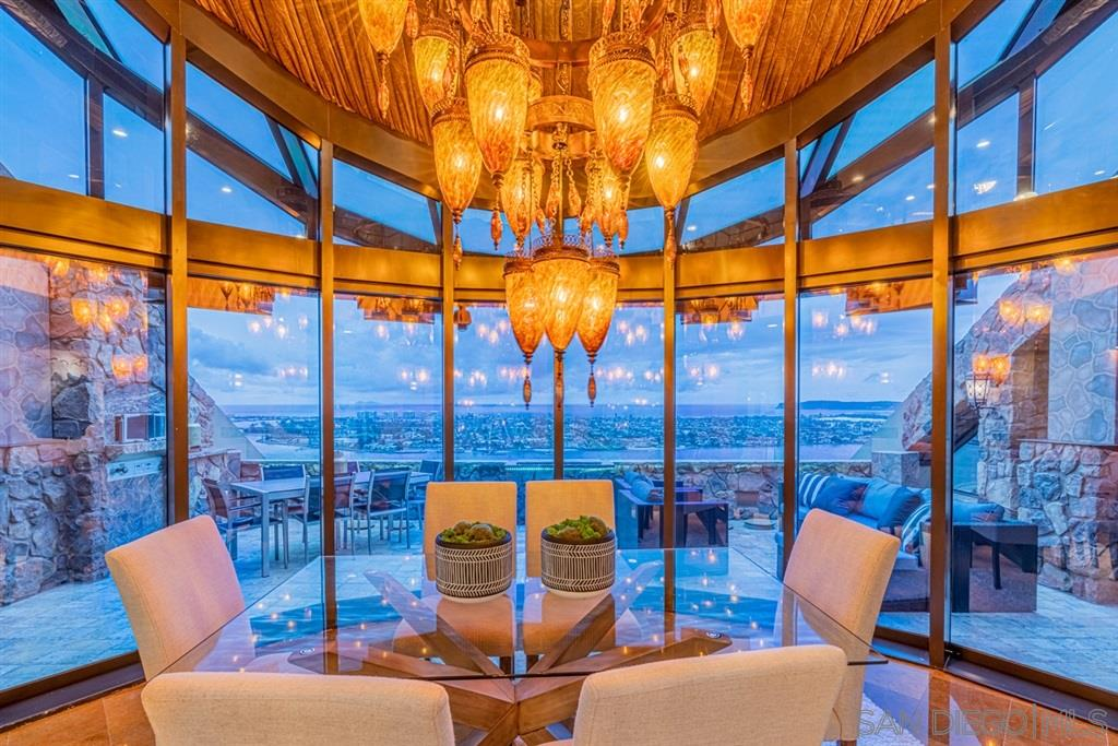 "This unique penthouse nicknamed ""The Nest,"" is a recently renovated Tuscan inspired 4,440 sq. ft. home sits 41 stories above downtown San Diego. Enter through the private lobby and be greeted by panoramic views of the Pacific Ocean, the San Diego Bay, and Coronado Island. A divine sense of privacy will wash over anyone who comes into this home. Smart home features help modernize the space along with brand new custom (see supplemental)cabinetry and flooring, bringing this early 90's original into the now. With three bedrooms and three and a half spa-like bathrooms, personal space is something to be had in abundance. The brand new gourmet kitchen offers everyone a place to gather to share a meal and a laugh. Just because this palace is in the sky doesn't mean it lacks in outdoor space – this penthouse boasts three large terraces with an outdoor kitchen and dining area. This home is truly a little slice of heaven."