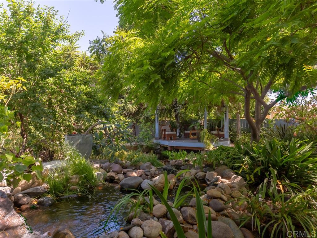 Https://www.matterbooks.com/openURL/QvejY31S3FPICNuukDdIYGoZB The award-winning garden will take your breath away, a space unlike any other. Seller acquired almost 2000 square feet of adjacent land, at a cost of $35,000, to create this paradise that features a fish pond with cascading waterfalls, and various outdoor living areas nestled on the canyon rim. The home itself is turnkey ready, and designed for easy expansion, should the lucky new owner desire additional space. 3rd Bedroom converted to office.There are so many special features to highlight. Including a new roof with   Corning 50 year, cool roof shingles. The interior and exterior have recently been repainted and new Cali vinyl plank, bamboo-like installed. The second bath has an over-size shower with a Vigo sliding glass shower door and Grohe fixtures. The kitchen is open to the living room, separated by a custom alder wood bar. The interior doors and trim are also custom designed and made of alder wood. You won't find anything like this elsewhere. The kitchen includes all the stainless appliances, most new within the last year. The microwave is a space-saving, under counter, drawer unit. The Delta faucet is a touch-on, touch-off fixture. The home has 200-amp electric service and a prepaid lease for the solar panels. The lease is transferable with no cost to the buyer for the system over the remaining 10 years. The water supply lines have been re-routed through the attic, eliminating any costly slab leaks found in older homes.