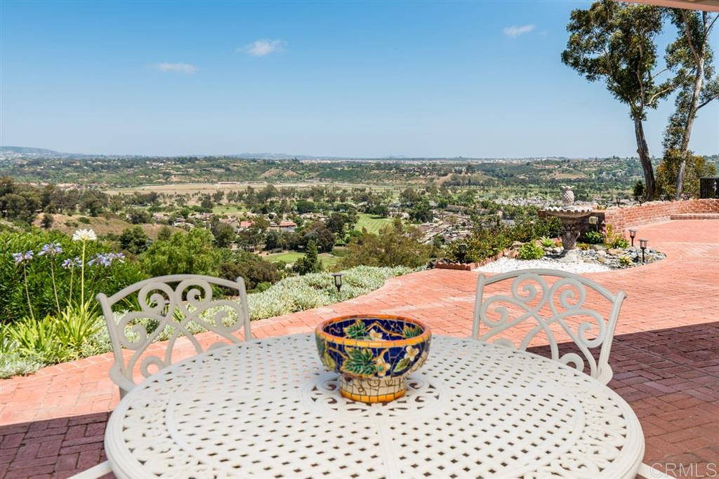 If Views & location are top on your list, look no further! A long private drive leads you to a charming classic ranch impeccably remodeled w/sit down Spectacular 180 degree views! Upon entering you are welcomed w/ large windows bringing the outside in, spacious room sizes w/ no detail left undone. Custom cabinetry & beautiful finishes to be found thru-out, Gourmet kitchen w/ chef's  pantry, Gorgeous master suite w/sweeping views, Owned Solar & so much more. see supplemental remarks.....Outside enjoy amazing privacy with multiple places to take it all in, Bocce court on the side, multiple fruit trees & plenty land to do much more. This is truly an amazing opportunity to own on one of Ranch Santa Fe's most desirable west-side streets with access to both Lomas Santa Fe and Via de la Valle