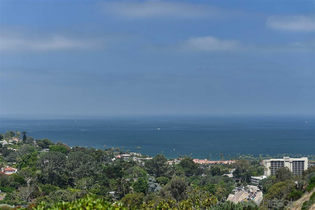 In a picturesque ocean, sunset, and lush natural canyon view environment, this immaculate, beautifully renovated residence is designed for exceptionally upscale aesthetics and comfort. Turn-key perfection offers broad, bright, open living areas opening to an expansive sea view deck, super sleek bathrooms and kitchen, and fireplaces in living room and master suite, community pool, spa & tennis. An impressive value in a superb location with easy access to village, LJ Shores, UCSD, YMCA, Schools & freeways.