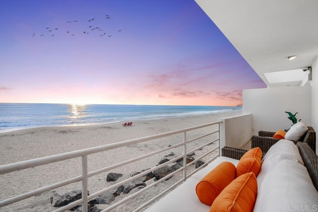 Live your dream on the sand in the exclusive Del Mar Beach Colony enclave. No expense was spared in 2016 when it was completely rebuilt with the highest quality level. The contemporary beach-chic styling offers Modern amenities & exceptional one-of-a-kind details. Vanishing glass doors open to the fresh salty air & breathtaking ocean views. Lavish main floor master retreat w/fireplace, sleek bath w/steam shower, heated floors, & private patio. 2 spacious Br suites w/walk-in closets &... (see supplement)easy access to the ocean front deck. Stunning state-of-the-art kitchen opens to a large deck to entertain & enjoy spectacular sunsets. Smart home automation. 2 car attached garage plus 4 additional parking spaces for guests. Can be purchased completely furnished for a turn-key experience. Seller combined two units in this privately gated condo complex designed by Batter Kay architects to feel like a single family home. Offering all of the benefits of an HOA for only $5000/yr. to include the shared maintenance, restrictions on short term rentals and more all to provide protection for homeowners.
