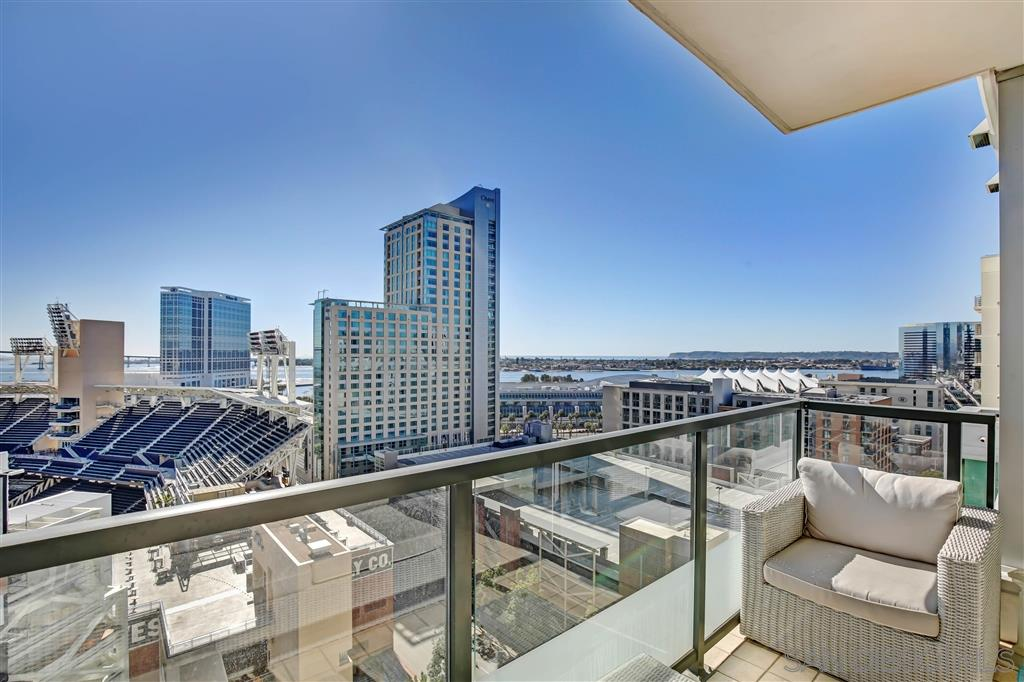 STUNNING LIGHT & BRIGHT 15TH FLR  SOUTHWEST VIEWS OF OCEAN CITY HIGHRISE SCAPE-EXPANSIVE WINDOWS-OPEN KITCHEN FLOOR PLAN-GRANITE COUNTERS-STAINLESS STEEL APPLIANCES-HARDWOOD FLOORING-VIEWS LOOKING INTO PETCO PARK-SPACIOUS BALCONY-LARGE WASHER FRONT LOADERS-EXTRA SPACIOUS MASTER (TWO CLOSETS). THE LEGENDS OFFER STATE OF THE ART AMENTIES: 7TH FLOOR ROOFDECK (GRILL-PARTY-LOUNGE-ENJOY PETCO PARK FESTIVITIES) DRY & STEAM SAUNA -POOL-FITNESS CENTER- PERFECT PARKING SPACES AND STORAGE CONVEYS.MLS Information Disclosure: All information is provided by owners and is not guaranteed. The accuracy of all information regardless of source, including but not limited to square footages and lot sizes, is not guaranteed and should be independently verified through personal inspection by and/or with the appropriate professionals.