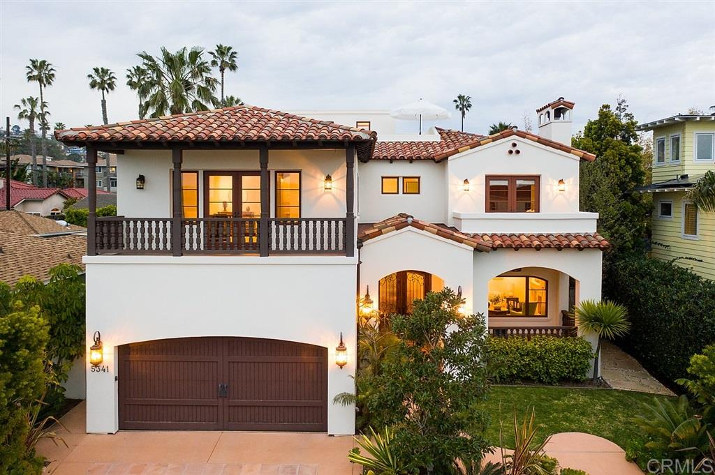 This Spanish masterpiece of design and finishes offers a grand entrance with custom double doors and beautiful foyer. This 5BD/3.5BA home features a private guest suite downstairs along with a formal living room with a fireplace, dining room, Gourmet kitchen with custom Chef's Island open to family room which opens to covered outdoor loggia with Built-in BBQ - a perfect place to gather with family and friends.This home takes advantage of the indoor/outdoor living spaces and all bedrooms lead out to a terrace. Relax in the large blooming master suite and enjoy the ocean views, balcony, walk-in closet, custom over-sized shower, soaking tub, dual sinks and separate vanity. The home is meticulously maintained with incredible upgrades throughout, custom window treatments, landscaping with tropical plantings, turf, French drains and more! Take in the vibrant sunsets from both the second level & spacious rooftop deck. Other great features include the wonderful location, numerous entertaining spaces, an outdoor shower, and built-in BBQ. Located in the idyllic neighborhood of Bird Rock, just a half block from the water and short distance from Calumet Park, restaurants and shops make this a treasured coastal gem.