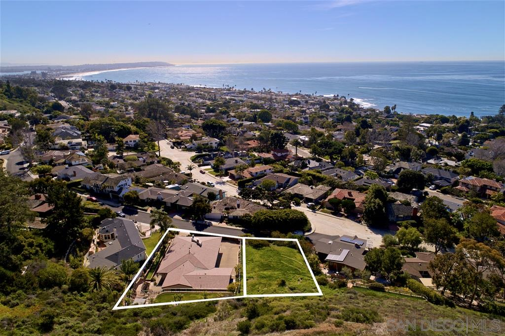 Being offered together, 6031 Folsom Drive (Vacant Lot, APN 357-182-06-00, MLS#200015572) and 6051 Folsom Drive (2,728 sf Detached Residence, APN 357-182-07-00, MLS#200015451), at a combined discounted asking price of $4,495,000.  6051 Folsom Drive - Originally Built and designed by acclaimed Master Architect, Lloyd Ruocco, this 2,728 square foot Timeless Modern Masterpiece was completely renovated in 2002 with a complete exterior refurbishing as well as a new interior design and layout.  See Supplement.Reminiscent of the original Lloyd Ruocco design, floor-to-ceiling walls of glass and wood beamed ceilings were significant features that were retained throughout. Located on an oversized 12,500 sf lot in the Upper Hermosa neighborhood of La Jolla, the property has true panoramic ocean views as well as beautiful sunset views which can be seen from both the master bedroom retreat as well as living areas throughout.  The chef's kitchen opens to both living areas and has stainless steel appliances with a Viking commercial grade range, custom cabinetry and granite counter tops.   All three bedrooms have bathrooms en suite and have custom built in closets.  The yard has numerous patios, extensive hardscape and a large upper level view deck with grass area and jacuzzi/spa where beautiful sunsets and serene treetop lined views of the southern coastline can be seen.   The neighboring undeveloped 10,391 sf lot, 6031 Folsom Drive, is also available for sale and both properties can be acquired together or separate.