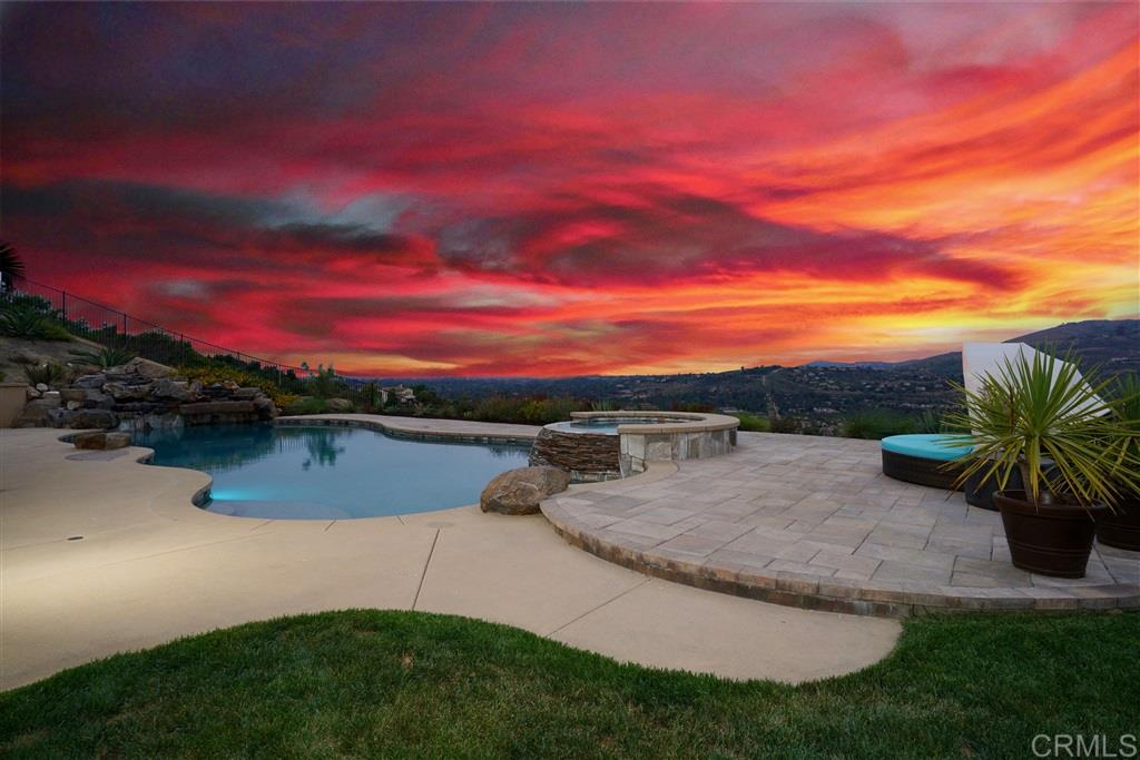 Don't miss this incredible single-story Sevilla home in Rancho Santa Fe. Perched on a promontory overlooking The Lakes and Crosby this home offers panoramic views from the mountains to the coast! Separate casita, private courtyard, highly upgraded kitchen, large entertaining & living spaces. Huge resort-style backyard with pool and spa, BBQ, lawn, playset & stunning sunset open space views! Tons of upgrades, two solar systems (electric & pool), and luxurious living in this coveted guard-gated community.Don't miss this incredible single-story Sevilla home at the Lakes, perched on a hilltop with panoramic views from the mountains to the coast! Enjoy tons of upgrades throughout and a highly desirable, private lot at the end of a cul-de-sac.  Step through the front door to a charming courtyard graced by a loggia and fountain. The casita is across the courtyard from the main house, featuring beautiful hardwood floors, a walk-in closet, and plantation shuttered windows on both sides that flood the space with natural light. The full bathroom has a tile floor and a glass walk-in shower. Perfect for seniors or guests! No expense was spared on the home's upgrades: two solar systems, beautiful new hardwood flooring, crown molding, and plantation shutters throughout.  The gourmet kitchen was designed for entertaining with stainless steel GE Monogram appliances, a dual oven, 7-burner gas range, a huge island with barstool seating, and granite countertops with a granite full backsplash.  The butler's pantry to the dining room features a wine fridge and walk-in pantry. The huge dining room is fit for a large party, with a built-in tile-front gas fire feature for unparalleled ambiance.  The glass French doors in the spacious home office open to the entry, with large windows overlooking the courtyard. The great room opens to the backyard with a double sliding glass door for seamless indoor/outdoor living. The family room features a modern tile front fireplace, a surround sound syste