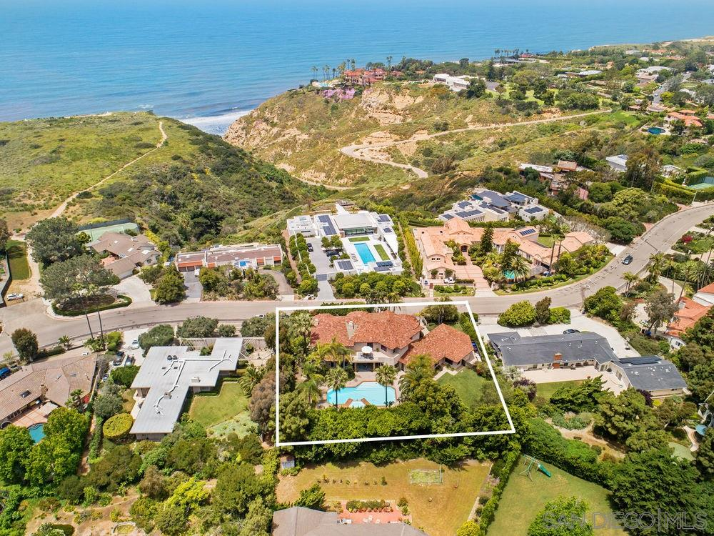 In the premier neighborhood of La Jolla Farms, this timeless Mediterranean with ocean views is the ultimate turnkey family home. Ultra-private and flat half acre + lot with mature landscape provides ample space to play with pool, lawn and built-in amenities. Nearly 7,300 SF home has soaring ceilings, entry level master, 5 beds, 6 baths and 4 bonus rooms including soundproof music/theater room. Enjoy surrounding nature trails, great accessibility, top rated schools and deeded car access to Black's Beach.