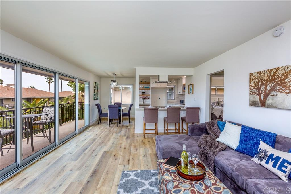This beautifully remodeled La Jolla condo is minutes from the ocean and walking distance to Windansea, Tourmaline Beach and all the shops & eateries in Bird Rock & North PB. The home covers electric & utilities w/ the HOA fee, and features ocean views off its wide living room balcony, vinyl plank flooring, designer tiled showers, quartz counters & white shaker cabinets throughout and stainless appliances. Its open floor plan has tons of natural light and a private balcony in the master. This won't last!