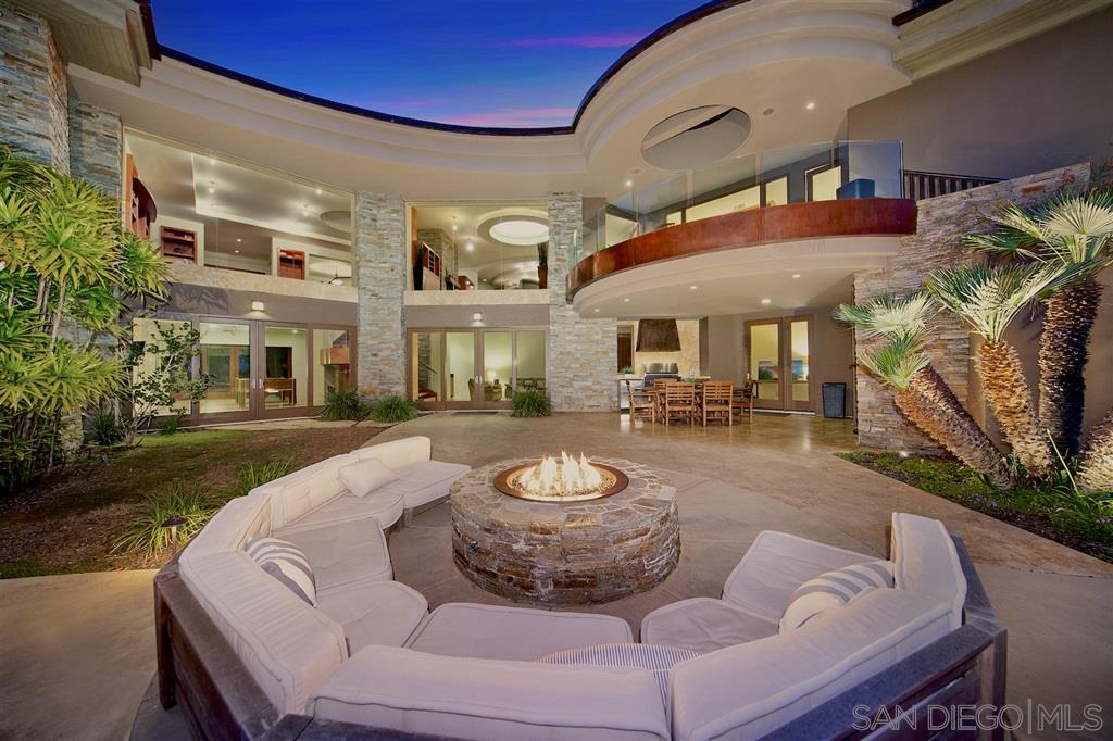 Seller to entertain offers btwn $3,748,000-4,098,000. Luxury, style & sophistication define this distinctive contemporary residence. Best of renowned Architect Don Edson. Resting on almost 1/2 acre at end of cul-de-sac, this architectural masterpiece provides quality craftsmanship & design aesthetic leaving you breathless! 5 exceptional en suite bedrooms, 6 full bathrooms, exquisite custom appointments & abundance of natural light. Hidden backyard oasis surrounded by nature & views of Pottery Canyon.2 additional offices/bedrooms, 2 family rooms, and a breathtaking great room,a sleek gourmet kitchen offering chef quality appliances, custom cabinetryand a beautiful breakfast area. From the moment you arrive, you will be awe-struck by the artistic entry foyer with natural light playing off high ceilings, and an impeccably appointed interior utilizing a luxurious palette of quality materials such as fine mahogany wood floors, impressive stone fireplace, gigantic picture windows overlooking the lush green backyard and pool. Expertly designed to accommodate both large scale entertaining and everyday family living. Also notable: first level master suite with his and hers walk-in closets, rejuvenating spa tub, separate shower, and bidet.Enclosed separate study area adjacent to chef's kitchen.Plus an expansive basement storage area.
