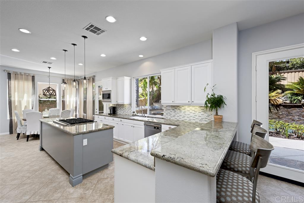 Seller will entertain all offers of $1,899,000-$1,949,000. Beautiful Lexington home in the coveted Sage Canyon neighborhood. Fall in love w/ the resort style yard including a pool/spa, water features, BBQ, island w/ seating, fire pit & great privacy. The oversized kitchen has white cabinetry, designer fixtures, granite/back splash, & SS appliances. Newer carpet in bedrooms, AC & frameless master shower door. Easy to convert office/garage into a spacious casita w/own entrance. Walk to Sage Canyon school!