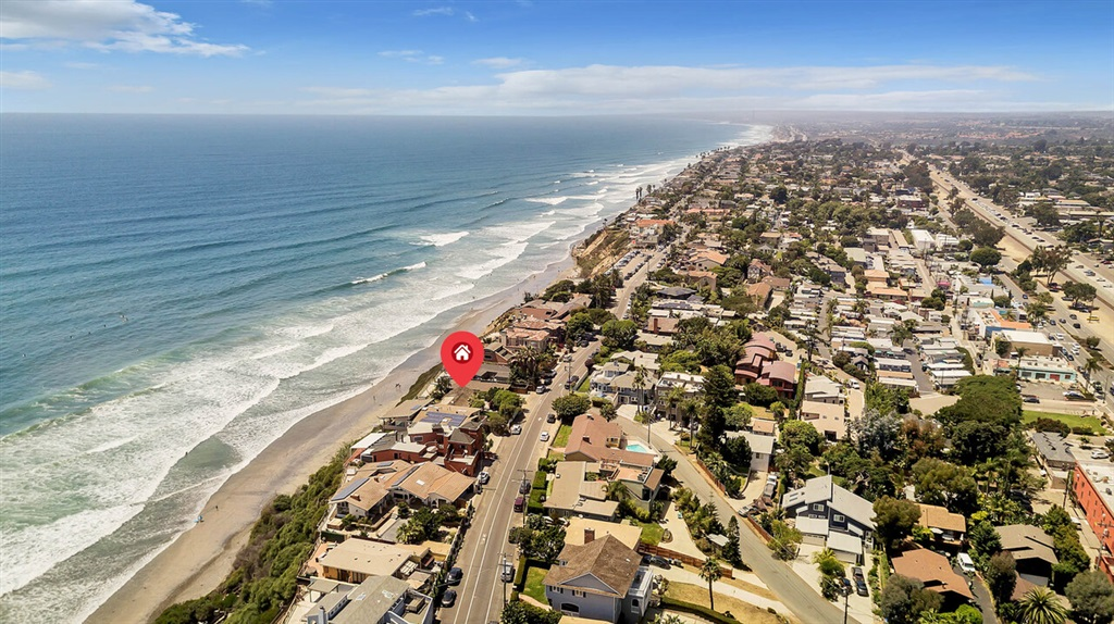 Charming Beach cottage on a large lot with lower seawall and upper bluff caissons. From the moment you open the front gate you can see the beautiful blue ocean water. This single level home sits on an irregularly shaped lot resulting in almost 60' of frontage on the Ocean which gives you even more panoramic views and a lush grass west yard. The east side yard is spacious, very private, and beautifully landscaped, with room for future home expansion. Only 11 lots to Beacons Beach access. shorturl.at/bHLPZCharming Beach cottage on a large lot with lower seawall and upper bluff caissons. From the moment you open the front gate you can see the beautiful blue ocean water. This single level home sits on an irregularly shaped lot resulting in almost 60' of frontage on the Ocean which gives you even more panoramic views and a lush grass west yard. The east side yard is spacious, very private, and beautifully landscaped, with room for future home expansion. Double doors lead from the patio into a large living room with oversized windows. Amazing views from the living room, dining room, kitchen, breakfast area. This home is only 11 lots to Beacons Beach access and steps from shopping on dining on the 101.  Rare opportunity.