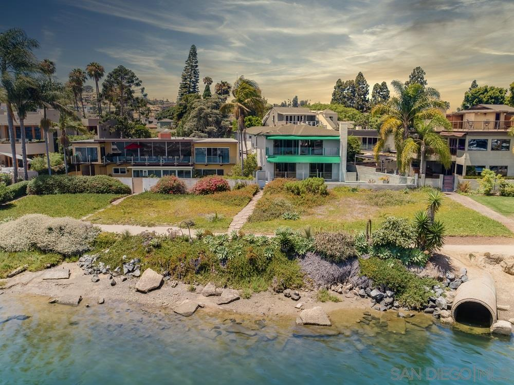 This is a rare opportunity to own a home directly on the San Diego Bay overlooking the Marina at the world famous San Diego Yacht club  Walk out your pool and spa area to the Bayfront walking path which is a short distance to restaurants, shopping, post office and more.  This home is even walkable to the famous Humphrey's concert venue.  The views are incredible with panoramic views of the San Diego Bay and Marina. This is a golden opportunity to remodel or build your dream home in an unbeatable location!This is a very rare opportunity to own a home directly on the San Diego Bay overlooking the Marina at the world famous San Diego Yacht club.  Most everything you can imagine in a Southern California lifestyle can be attained at 991 Scott.  Walk out your pool and spa area to the Bayfront walking path which is a short distance to restaurants, shopping, post office and more.  Very easy access to your water recreation on the bay!  This home is even walkable to the famous Humphrey's concert and entertainment venue.  The views are incredible with panoramic views of the San Diego Bay and Marina.  The sound of the Seagulls flying over the Bay while enjoying the water breezes will make you feel like you are on a permanent vacation. This is a golden opportunity to remodel or build your dream home in an unbeatable location, where you can live an unequaled Southern California lifestyle.