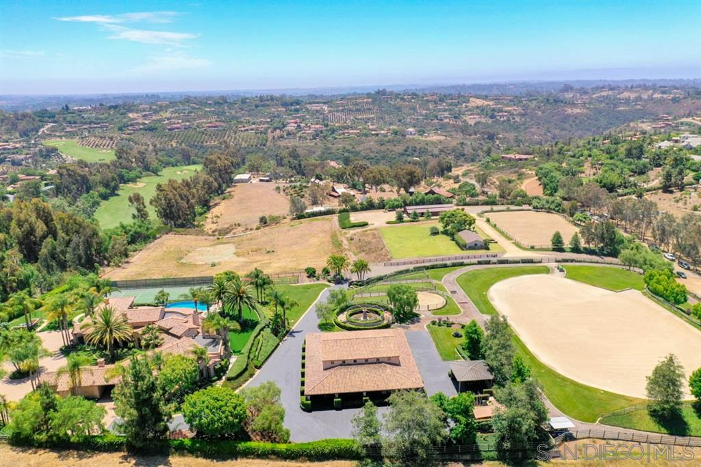 Rare Opportunity to own an equestrian estate including 10 usable acres with two separate parcels. Properties are also offered separately, MLS#200034253 & 200034261. Exceptionally quiet, private location overlooks the Bridges golf course with panoramic golf course views. 3468 is complete with spacious custom home and guest house, infinity edge pool, tennis court, 9 stall barn w/ living quarters plus every horse amenity. 3465 has an additional 10 stalls, arena, cottage & plenty of land.3468 Property includes owned solar, which runs the entire property. Equestrian improvements are truly exceptional, designed for world class show jumping with a lovely barn including full living quarters. Own both parcels and create an amazing family compound. Ride on dedicated Encinitas trails for 30 miles and beyond. Location is extremely private and quiet yet is close to restaurants, retail and beaches, with cool coastal breezes.