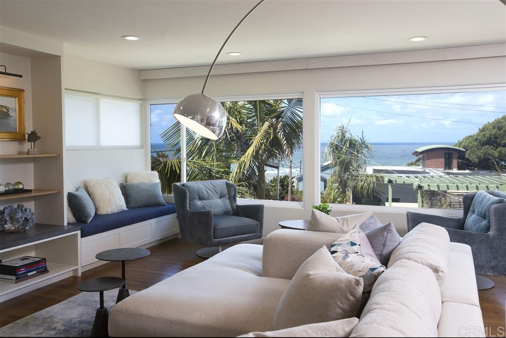 """Spectacular Sunset Cliffs retreat offering white water views of the Pacific, 4 bedrooms and 3+ baths on an elevated 6,800 s.f. Lot! Upon entering through the custom solid wood front door with unique side lights, you immediately notice the rich expanse of polished wood floors, highlighted by sunshine streaming in through the """"His & Her's"""" office and the south-facing patio & fire pit to your left. The exquisitely finished floors and oak stairs beckon you to explore further. **See Supplement Below** See the well appointed kitchen with large island, """"prep"""" sink, Dacor range, beverage fridge & walk in pantry. As you ascend the beautiful stairs to the living and dining rooms, you are treated to a spectacular view of the Pacific. Stroll out to the covered deck and take in more of the scenery or enter the Master suite through its adjoining French door. The spacious living room includes a hidden entertainment center and remote controlled window coverings. While in the private master suite, take in the impressive master bath with marble tub surround, separate shower enclosure and dual vanities. Before exiting the master, don t miss the large walk in closet or the meditation room, accessible from the antique rolling library ladder (sq. ft. not included in total). From the main entry you may access the other bedrooms, each with a beautiful view of the garden and access to the tastefully remodeled full baths! Continuing down stairs to the light & bright yoga and family rooms, you pass delightful art niches and a private wine cellar. Outdoors you'll enjoy the gas fire pit, water feature, koi pond and secluded spa! The long driveway, accessible from the alley through an electric rolling gate leads to the 2 car garage. Steps to the ocean, this exquisite home offers it all; location, views and a wealth of unique features to delight the most discerning home owner."""