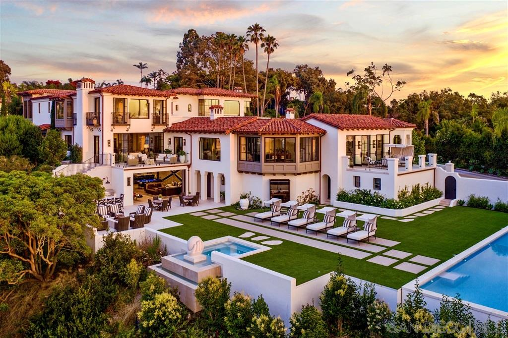 "This recently completed architectural masterpiece sits on the rim of Bluebird Canyon boasting sprawling views of the Pacific Ocean, La Jolla Country Club and the charming Village of La Jolla.  Reminiscent of a Four Seasons Resort, this exceptional Contemporary/Spanish home is meticulously designed with over 12,000 sf of details that will leave you breathless: Private gated compound, 6 bedrooms w/en suite baths including casita w/ kitchen and living area,  see supp.remarks belowCont.  maids quarters/gen suite w/ full kitchen and separate entrance, catering kitchen,  fully appointed ocean view gym w/spa bath, sauna and steam room, 180 degree ocean view library/office w/hospitality kitchen, game room w/ 2 lane bowling alley, wine cellar, citrus garden w/BBQ , Pool level outdoor kitchen/dining and fire pit overlooking the ocean.   Warmth abounds inside and out in multiple courtyards; the sunlit ""Coffee Court"", the fragrant ""Garden Court"" with ""she shed"" and commercial dog bath and the fire-lit ""Private interior Courtyard"". Multiple ocean view balconies and the ""Romantic Ocean View Terrace"" over look a 65 foot long pool and jacuzzi. Truly a piece of art and an entertainers dream."