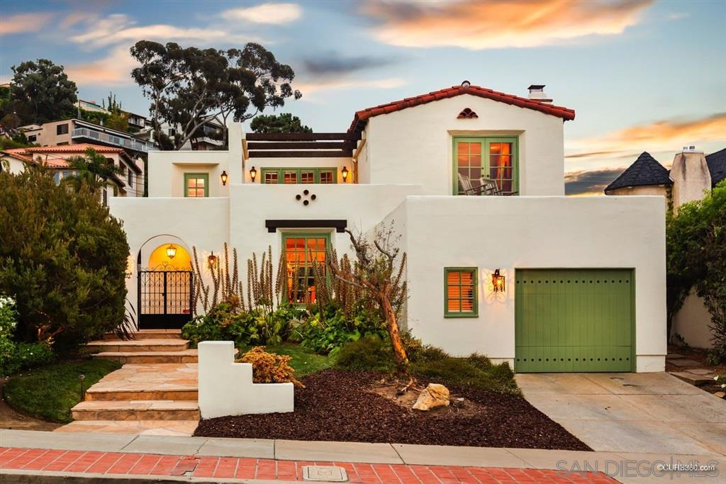 This beautifully remodeled & restored 1920's Spanish style home in the heart of the Village combines the charm of the original Spanish revival with the comforts of the present. The home features views to the ocean, three bedrooms with a large office, a full bed & bath on the first floor, and two single-car garages. The spectacular back yard includes a stone patio, built-in BBQ, bread oven, and an adjacent covered outdoor space. Meticulously maintained, appealing to the most discriminating buyers.This beautifully remodeled & restored 1920's Spanish style home in the heart of the Village combines the charm of the original Spanish revival with the comforts of the present. The home has been meticulously maintained, appealing to the most discriminating buyers. Originally built by Olmstead Building Company, this home has been restored with the finest materials, including iron gates, wood doors from San Miguel de Allende, and antique pavers from Portugal. As you enter through beautiful iron gates, you pass a tranquil fountain before entering the home into a gracious entry. After entering you see the attractive living room on one side and inviting dining room on the other side which features a Spanish style fireplace and built-in bookcases. The downstairs powder room features antique cabinetry and a limestone trough sink. The kitchen features a Miele dishwasher, Sub Zero Refrigerator, Wolf Oven, 6 Burner Gas Wolf stove, and Jerusalem Limestone Counter-tops. One of the bedrooms is on the entry-level with a private en-suite bathroom. The large office highlights double antique doors, fireplace, and custom shelving & cabinetry. One over-sized garage is on this level with access from Virginia Way and directly into the house. At the top of the stairs, you enter the spacious master suite featuring a fireplace, and deck with ocean views. The master bath has two oversized walk-in closets & tub/shower area. A loft area outside the master suite features built-in bookcases and access t
