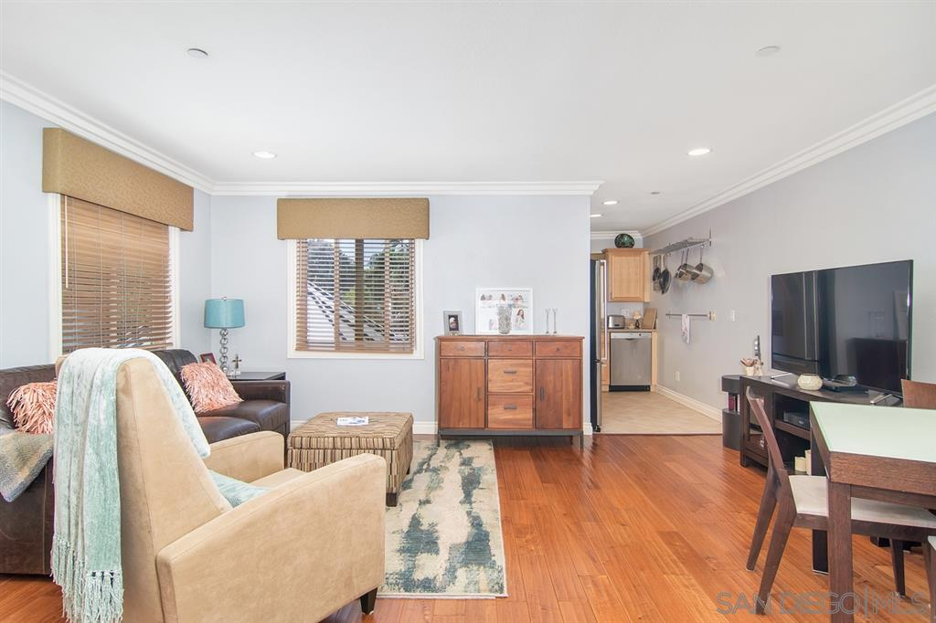 """Excitement in """"The Village""""! Don't miss this much sought after charming 2 bedroom unit a top of the La Jolla Marketplace! Upgrades galore, hardwood flooring, crown molding, Bosch dishwasher, Bosch oven/stove, granite counter tops, dual pane windows, forced air air conditioning & a built-in Murphy bed and desk. Set on the top floor spacious patio, enjoy the breezes and pinch yourself confirming that you're living in the La Jolla Village! Walk to it ALL! Gated community with 2 underground parking spaces!"""
