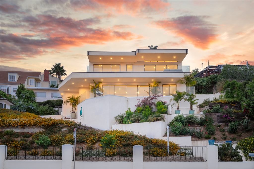 """Appraised at 3.4 Million. Hollywood Hills Glitz & Glamour meets San Diego. This brand new modern masterpiece showcases jaw-dropping unobstructable ocean, bay, city views from the living room, expansive balconies & 2 master bedroom retreats. Solid Steel framing allows 9ft ceilings & sliding doors allowing indoor/outdoor living. Each bedroom features ensuite baths & walk-in closets. The master retreat features a modern fireplace, luxurious, expansive spa-like bath & walk-in closet. Hot tub views abound.Total 180 degree north, east, south unobstructed view of city of San Diego, San Diego bay, city of Coronado, Coronado bridge, Tijuana & Mexico, Pacific ocean.  Home framed out of structural steel with steel beams and columns to facilitate 9 ft ceilings throughout home. The contemporary structure with massive balcony and deck and maximum glass doors and windows and views where no interior posts block views. Structural steel allows for wide open floor plan with minimum interior walls and posts.  Fleetwood bronze framed & dual paned 8 ft. sliding doors throughout home. All windows bronze framed & anodized dual paned.  All interior doors solid core with black satin Baldwin hardware.  High end stainless steel appliances.  High gloss lacquer white cabinets throughout with black satin Emtek pulls.  Plumbing fixtures Kohler & American Standard & raintree shower heads in all bathrooms.  Luxurious master bath with 12"""" Riobel round rainhead & see through shower window to the city & bay.  Huge master closet.  All en suite bedrooms with showers and walk in closets.  Glass railing on balconies ½"""" tempered hurricane proof glass.  Fully usable 600 sq ft basement with 9 ft ceilings for bedroom, home theater, wine cellar, office with full bath. Constructed out of reinforced concrete block and has self contained heating & air conditioning with 12,000 BTU mini split system with remote control.  Each floor has its own separate heating & air conditioning system.  State of the art Navien tank"""