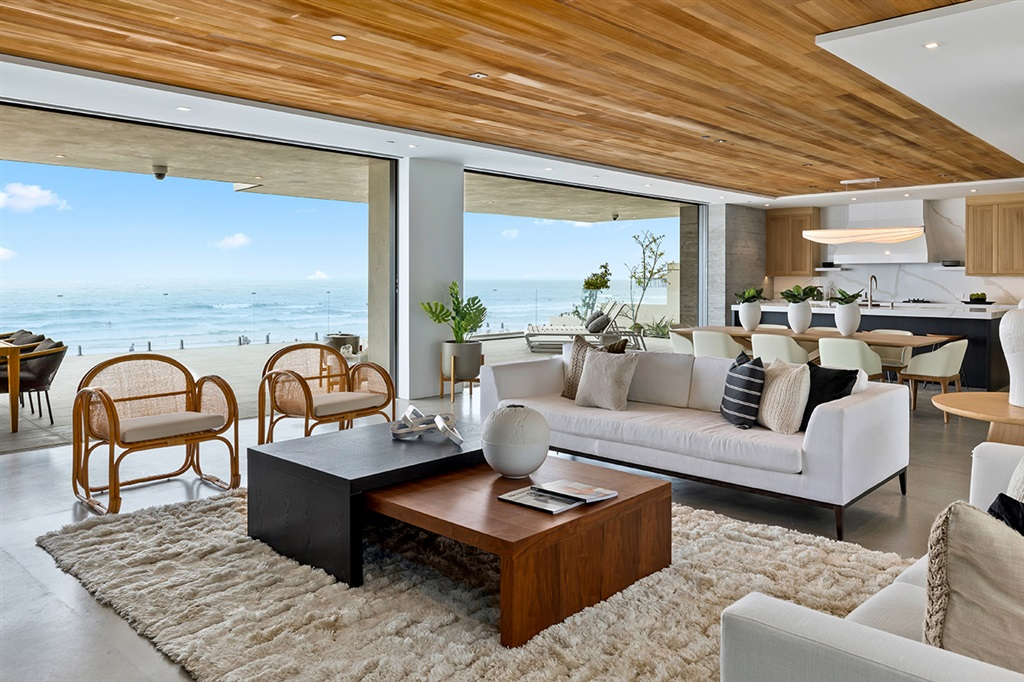 BRAND NEW, Exceptional Oceanfront on the white sands of La Jolla Shores. Welcome to the ultimate in luxurious beachfront living. This Bill Hayer-designed masterpiece, five years in the making, uses only the finest in materials, craftsmanship and conveniences and could not be replicated today. From the Michelin-star kitchen and premium smart home system to the Jacuzzi on a cantilevered 1,275 SF deck, excellence in design and livability is readily apparent. Enjoy nearly 60 ft. of frontage and epic surf.Built in 2020 after 5 years of meticulous work, this rare La Jolla Shores oceanfront, with more than 6,000 SF of habitable space, is finally here. Exceptional waterfront living, exquisite materials and an inviting palette are de rigueur. Floors are polished concrete and European cut white oak. Cabinetry and doors are rift white oak. Western door and window systems offer unobstructed views of the beach and Pacific. There is perfect indoor/outdoor living flow and a Jacuzzi on the 1,275 SF, cantilevered main living deck. A home like this cannot be replicated due to the coastal commission's bluff line ruling. An inspired kitchen features commercial-grade appliances, 3 sinks, large SubZero wine refrigerator, smaller SubZero wine refrigerator, commercial refrigerator and separate freezer, ice-maker, 2 ovens, microwave and 2 dishwashers. The home has the latest Creston lighting and smart home system. The roof is copper and some of the home's ceilings feature inlays of sand-blasted cedar. Upper decks and bathroom floors are Metal Max porcelain tile. With four bedrooms, the home features two fireplaces, an elevator, exercise room and large garage.