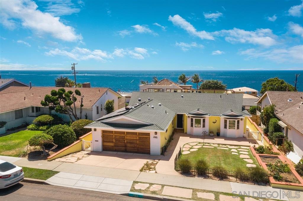 Ocean views, surf, and sunsets are yours from this remodeled single level beach house just steps to the Pacific and Sunset Cliffs Natural Park. Spacious and light-filled, with a huge open floorplan that leads out to the sparkling pool & multiple view decks. Upgrades include solar panels, a chef's dream kitchen with a 6-burner Viking range & griddle, full size refrigerator/freezer, hardwood floors, dual pane windows, skylights & more. You'll enjoy summer all year long and wonderful neighbors. Welcome Home!