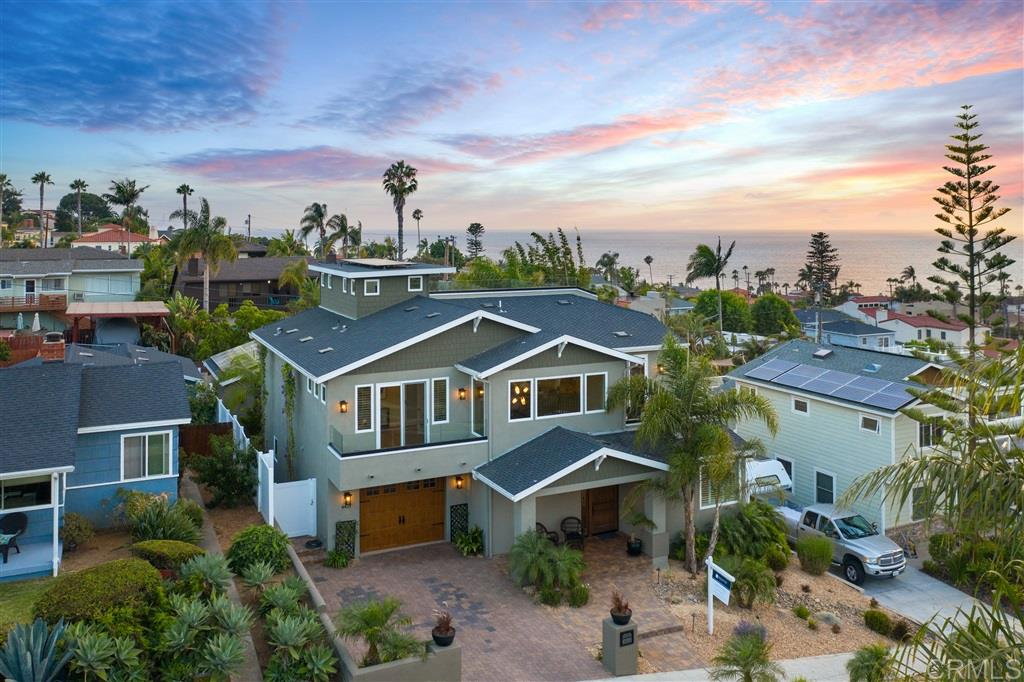 This stunning custom home will wow you w/panoramic ocean views from almost every room in the house! Roof top deck provides endless views & beautiful sunsets. Chef's kitchen has commercial grade details- thermador appliances, wine refrigerator, reverse osmosis system, custom cabinets, touch faucet & more. Solar! View decks located off living room & roof top. Reverse floorplan w/3 bedrooms down-all w/ensuite baths, and 1 bedroom & full bath on the main level.Short walk to Sunset Cliffs.Perfect for entertaining, the roof top deck offers full size bar, refrigerator, custom built in BBQ, TV Setup and Jaccuzzi Tub. LED lighting throughout the home and Iphone Smart Wiring for control of heating, cooling, alarm & sound system. Solar is paid for and provides very low electric bills! Alabaster light fixtures with beautiful alabaster chandelier in the foyer. All house vacuum. Fabulous fire and ice fireplace in the great room. Attached garage AND an open air garage with alley access. Soft water throughout the home. Live the southern California dream!