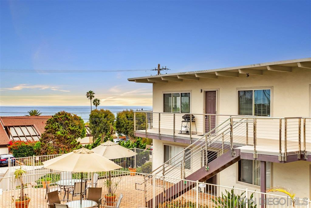 Absolutely charming 2 bedrooms, 1 bath and 812 square feet beach condo located in the gated Sea Cliff Terrace community! Come home to this relaxing retreat that boasts spectacular ocean views, fantastic open layout, and gorgeous wood ceilings. Primary bedroom has access to stunning views of the ocean. Shared full bath features tile flooring and a shower/tub combo with glass enclosure. In-complex parking spot.Just a short walk to the beach, neighborhood parks and shopping.