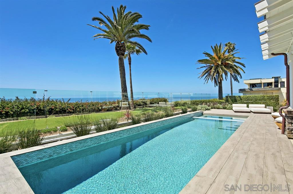 The ultimate location in Olde Del Mar, this brand-new construction, oceanfront home is an entertainer's dream destination. Designed in collaboration with Samuel Amoia and built by Zephyr Development, this 4 bedroom, 6 bathroom home spans an unheard of 6,283-square feet on one of Olde Del Mar's most coveted addresses. Spend the day poolside or enjoy shopping and fine dining all within walking distance from this ocean front masterpiece. Welcome home. See supplement...Spend the day poolside on one of four separate outdoor dining and lounging areas, comprising 650-square feet. Putt around on the pristine golf green, catch amazing sunsets by the fireplace in the family room. Toast your friends and family in the open kitchen, fitted with top-of-the-line appliances and Hampton's style cabinetry. Boasting three stories, and wrapped in the colors and textures of nature, this open floor plan home excludes light and air in every crevasse. The master sits on the top floor, with panoramic views throughout the suite, with a seamless corner wrap-around bathroom window showcasing views from the free-standing tub, glass steam shower and His & Hers double vanity. Counterspace and storage abound in this white-on-white space, further illuminating the brightness.  A stunning closet island, built-in Meile coffee machine, washer and dryer and wall safe are cleverly tucked into the master closet. A second bedroom is also on this top story, with two more on the basement level. The basement level, perfect for out-of-the-sun entertaining or relaxing, also offers a full gym, dry sauna and restorative steam room. Also on this level is the home theater, with seating for 12 and a temperature-controlled glass wine cellar and full bar. A large elevator makes easy accessibility to all levels. Located at the end of a long drive, this Smart Home is surrounded by native landscaping, including two massive majestic palms. Due to its proximity to the coastline, privacy is first-rate. All interior doors ar