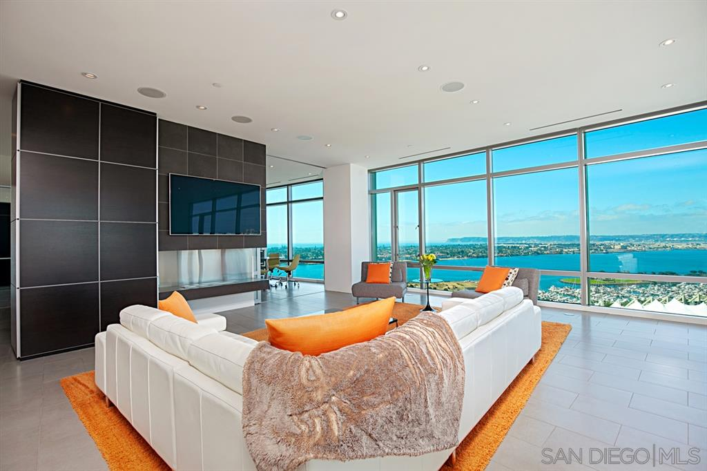 """Possibly best condo in San Diego. Featured twice in San Diego Magazine. Incomparable & UNOBSTRUCTABLE views of Bay, Ocean, Point Loma, Coronado, Mexican islands. Award-winning custom-built light bright open modern 3,138 s.f. home in the sky. 10' floor-to-ceiling windows. Huge open chef's kitchen & Great Room.  Wonderous master with bathroom selected best in SD. Separate wing: family room + 2 bedrooms.  Most exclusive community downtown atop the Omni Hotel. See supplement. . .One-of-a-kind penthouse in a one-of-a-kind aerial community. No other residence, anywhere, has a view that beats the dynamic and panoramic view from this residence - Bay and marinas, Coronado Bridge, Coronado Island, Point Loma, Pacific Ocean, Mexican islands & mountains.  This luxury penthouse was completed after seller purchased and divided half of the 28th floor.  Super high-end custom space-plan and configuration - the only residence of its size or layout in the Metropolitan.  This retreat was custom designed by renowned architect William Bocken, AIA.  No expense spared or detail overlooked. Views from every room (except laundry and powder). 3 parking spaces. 28th floor private storage room.  The Metropolitan is a small and exclusive community of about 35 ultra-luxury residences atop the Omni Hotel.  Residents are pampered with full-time concierge service, 24-hour security, their own private and secure entry, lobby, elevators, parking, and secret entrances from Omni; exclusive recently-updated club room and """"rooftop backyard"""" with pool, hot tub, fireplaces, BBQ. Residents additionally are served by the staff and amenities of the top-rated Omni hotel, including hotel pool, gym and fitness center, room service, laundry, housekeeping, catering, valet parking, business services, on-site restaurant, and a private sky-bridge to Petco Park.   Location, Location, Location!  Not only is the Metropolitan the most exclusive and luxurious downtown residence, but its location is perfect at the intersecti"""