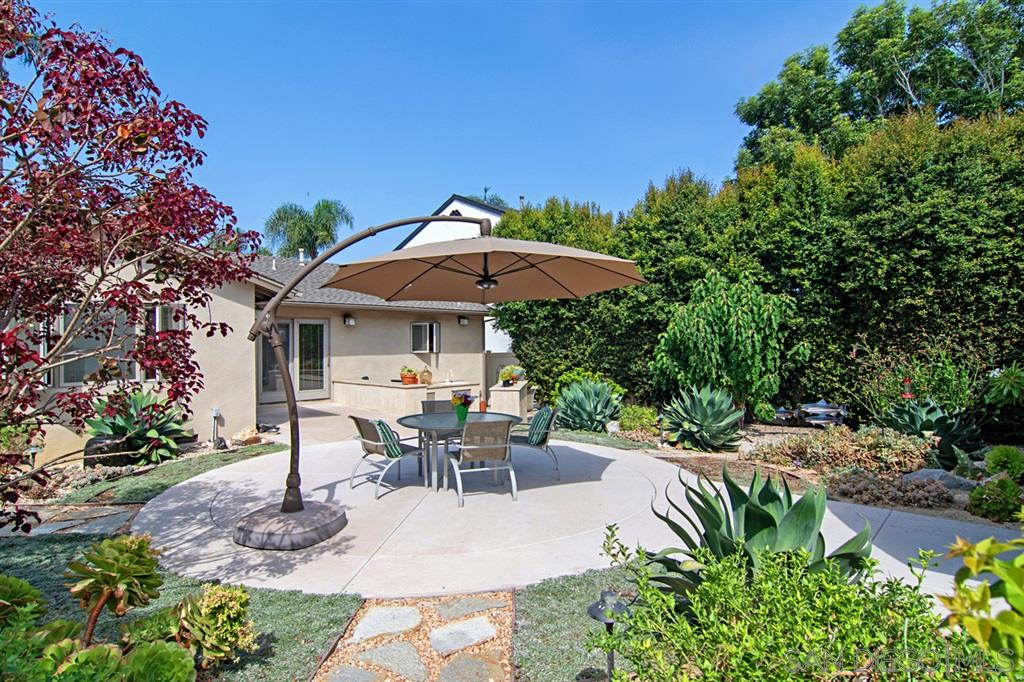 Featured in Better Homes and Gardens as Small and Smart - this incredibly designed home with separate guest house exemplifies one of the best uses of space professionally planned. The main house is a 2BR 2BA plus office (easily a 3rd bedroom), butler's pantry, wine center and laundry adjacent to the kitchen. The rear unit is 1BR, 1BA with kitchen, office area & living room. Separately metered with 2 addresses-lots can be split. All in the heart of the Village..A must see!* See supplement for more details.Pride of ownership exudes from this home....it has never been used as a rental/income property. The office can easily be converted to a 3rd bedroom (a closet, window and doors already exist).  Features include: Skylights, dual glazed windows, fireplace, bamboo floors ,granite counters and stainless steel appliances are just a few of the many features. The separate guest house is a fabulous one bedroom with living room, bath and kitchen. Both are separated with a large patio area and drought-tolerant garden. Beautiful specimen plants, a Japanese fountain and citrus & fig trees create a lovely & quiet retreat. Both are separately metered for electricity . Air Conditioning for both homes is included and each has finished garages with loads of storage+ built in cabinets. There are two view decks. Schematic plans are available to build up with an elevator for the main house. This is an opportunity for someone who wants  to live in the heart of the village and have a separate family unit or income property. The lot is large enough to also split.