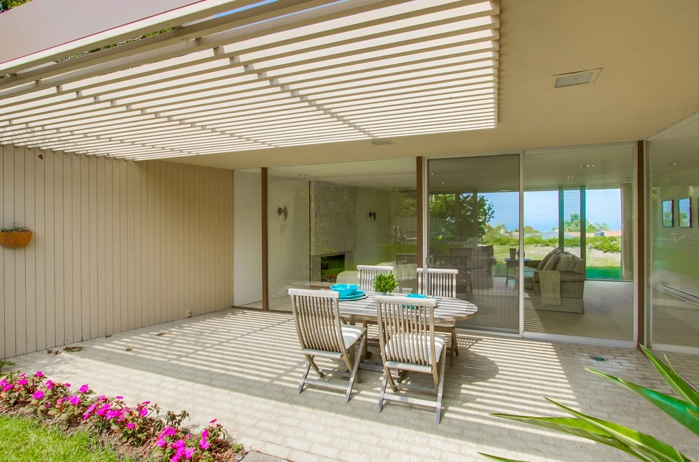 Seller shall respond to offers btwn 1.7 and 1.9. This single level mid-century modern home with ocean views is true to its original architectural vision. The floor-to-ceiling windows and doors create an open, spacious feel with an abundance of light. This well designed home exemplifies easy indoor-outdoor California living. The large kitchen (once a family room/kitchen combo) looks out to the lush and serene backyard. Situated on a 35 acre elevated, corner lot, it offers a generous flat yard with a pool.See the Virtual Tour link for additional pictures. One of the bedrooms and baths has a separate entrance, perfect for guests, or an extended family living situation. In 1970 the home was featured in Sunset magazine. The article mentions the Russel Forester designed guest suite and the dining patio, a direct extension of the living room partially covered by the outdoors' continuation of the ceiling. Extra room #1 is in Bedroom 2 (L shaped room). See the floorplan in the additional documents tab.