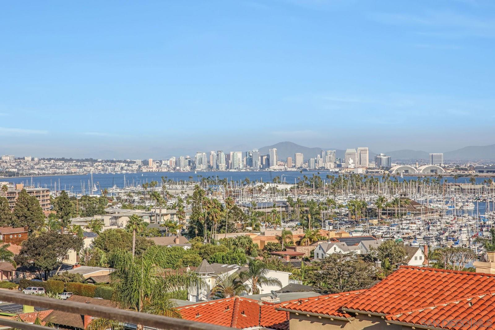 Welcome home to some of the best unobstructed views in Point Loma! Panoramic views of San Diego Bay, Coronado, Downtown & beyond from living room, kitchen, master & 2 bedrooms.  Indoor-outdoor living at its best with over 630 sq.ft. of view decks.  Spacious open-concept main living area features kitchen w/ large island, Dacor gas cooktop & dual ovens. Home offers elevator from garage to main living level. Upstairs is 3 beds and 3 baths. Serene private backyard features fountain & lush landscaping.Located in the heart of La Playa just 1 block to Bessemer trail with sandy beach access as well as walking distance to San Diego and Southwestern Yacht Clubs. This home has every detail covered including Brazilian Cherry hardwood floors, new plush carpet upstairs, recessed lighting, built in speakers, elevator from garage to main living level, trash & recycling chutes to garage and laundry chute from master bath to laundry room.  Garage features epoxy flooring and 2 full walls of built-in storage.