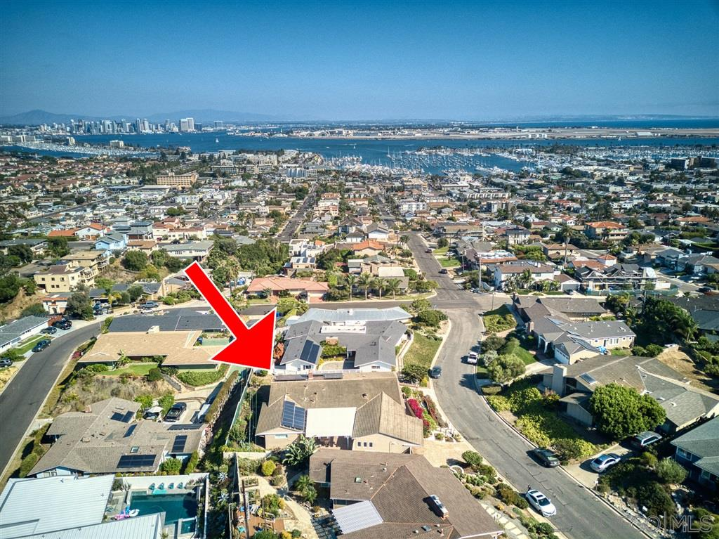 The BEST OF THE BEST! Opulent luxury, San Diego style! Over 180 degree unobstructable views of San Diego Bay, Downtown, Coronado Islands and the ocean, from the tip of Point Loma, to the Sea World tower! Lovingly restored single story on unique closed 2 block cul-de-sac, no traffic! Gorgeous Chef's Kitchen and luxurious baths! Finished 2 car garage with half bath, and lift for the groceries. Go green with the paid for solar system. Toast your forever house, to the twinkling lights of San Diego Bay!Enjoy unobstructable San Diego Bay Views from the living room, dining room, primary bedroom, main bath, and front bedroom (currently being used as an office). The all white, chef's kitchen has a huge center island, glass cabinet doors, high end appliances including a wine refrigerator, built-in refrigerator, shelves galore and a huge, pull-out drawer pantry wall. The main bath has a one way glass window, to see the Coronado Bridge in privacy. Every time you walk out of the kitchen, you see the Coronado bridge! The open floor plan living room has WOW! views, vaulted ceilings, a glass chip gas fireplace, wet bar with wine refrigerator and ice maker, and custom shelves everywhere. This great room opens through French doors and walls of glass to the rear covered patio with water feature that conveys. The primary bath has a heated floor, no step shower, plus an oversized, custom designed closet with views of the sunrise, sea world tower, and mountain thunderheads. The hall has more shelving, and glass door to the rear yard covered patio. The rear yard is a vegetable garden and the rest is ready for your bay view ideas. Off of the patio is the laundry room, for quiet use, including a large utility/pet washing sink, and extra storage. The bay view office room is the third bedroom, and has a rain glass slider door to the bath. In the 2 car garage is a lift for groceries, packages or wheelchair. Extras include forced air heat and air conditioning, plantation shutters, custom adjustable lighting through-out, built in speakers, retractable screens, tankless water heater, Pura-Flow water conditioner, front security gates, and the patio fountain stays. Go green with the paid for solar system. This central location is 6 miles from downtown without a freeway, and a sailboat view instead! Shops, restaurants and and yacht club are 1 mile away (6 minutes). Major chain groceries are literally a half mile away. The location is one of Point Loma's most unique closed cul-des-sacs, with no outside or cross traffic, and only 2 blocks long. This gorgeous home's former owner was an interior designer, this personal residence was lovingly restored with color and flair. Every meticulous detail was thought out, and superbly executed, creating your quality lifestyle. When you can have it all, come home to your exquisite San Diego Bay View!
