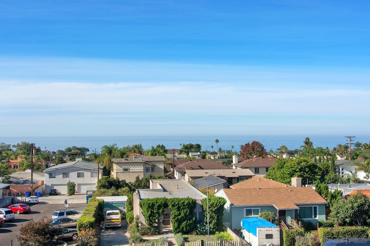 Enjoy the spectacular panoramic ocean views & cool ocean breeze on 2 balconies & roof top deck! This is your like new modern luxury home with indoor outdoor true beach style living, contemporary design showcasing panoramic ocean views in the heart of La Jolla Village. Sunny bright home with spacious open floor plan, soaring ceiling with architectural detailing, gourmet kitchen with high end upgrades. Walking distance to beaches, shops, restaurants, farmer's market, only 0.7 mile to the Bishop school!
