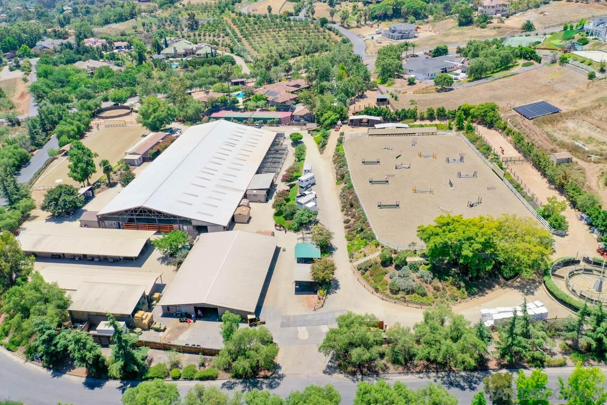 Dove Hollow features one of the only large, covered riding arenas in the Encinitas/Rancho Santa Fe area, along with oversized stalls for 40+ horses, plus two outdoor arenas sized for jumping, dressage or any equestrian use. Located in a peaceful, gated community on the 30+ mile Encinitas trail network, with lovely views, lush landscaping. turn outs, round pen, European horse walker, hay barn, ample parking & many other amenities, the property also includes a manufactured caretakers residence on site.