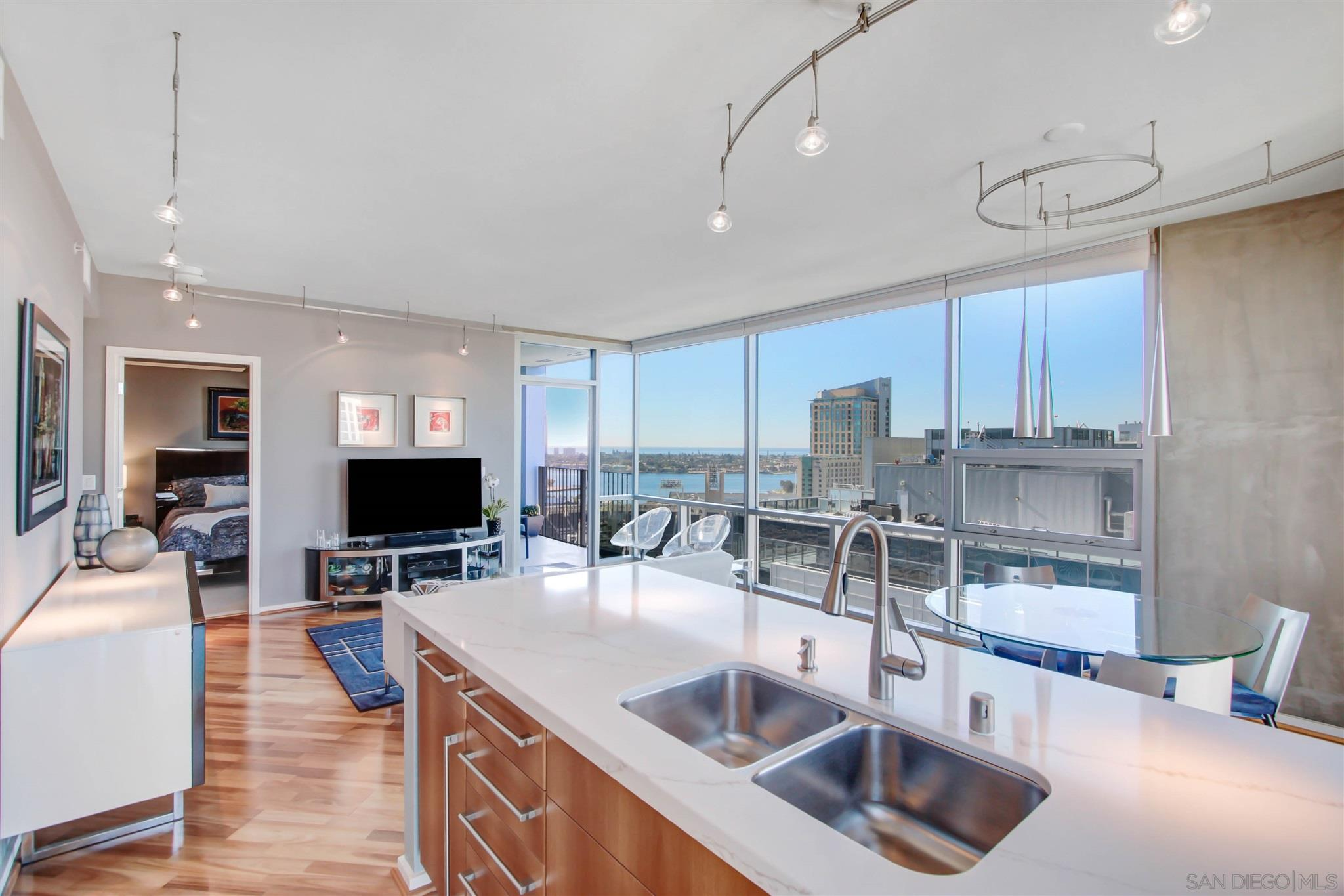 EXQUISITE IN EVERY DETAIL- 23RD FLR-PERCHED NEAR TOP OF THE HIGHRISE! WEST FACING WITH NORTH-SOUTH-VIEWS AS FAR AS THE EYES CAN SEE-OCEAN,BAY,CORONADO ISLAND,PETCO PARK HOME PLATE-CITYSCAPE -FLOOR-CEILING WINDOWS-REMODELED KITCHEN OPEN FLR PLAN-STAINLESS STEEL APPS--HARDWOOD FLR-SPACIOUS BALCONY SPLIT BEDROM PLAN-LARGE WALKIN CLOSET-DUAL VANITY MB-LARGE WASHEER/DRYER - ICONIC AMENTIES 26TH FLR ROOFTOP SKYBOX-1,700SQFT FITNESS,MULTIMEDIA THEATER ROOM-CLUBHOUSE-FIREPIT -STORAGEROOM+LOCKER+MOTORCYCLE SPACE!!VERY LARGE STORAGE ROOM+STORAGE LOCKER AND A MOTORCYLCE ASSIGNED SPACE ALL CAN CONVEY WITH SALE. ALL LOCATED ON THE FIRST LEVEL PARKING OF THE GARAGE! VERY RARE TO HAVE SUCH ASSETS ALL ASSIGNED WITH A CONDO AT ICON. MAKES THIS CONDO RARE.  FIRST TIME ON THE MARKET. ORIGINAL OWNERS. LOCATED IN ONE OF THE MOST HIGHLY DESIRABLE COMPLEX IN DOWNTOWN SAN DIEGO. ICON HAS ONE OF THE MOST ATTRACTIVE AMENTIES- LOCATION-ENJOY PETCO PARK VENUES FROM ICON'S 26TH FLOOR ROOFTOP OR FROM YOUR OWN RESIDENCE #2302 - HOA MANAGEMENT WAS HONORED WITH PRESTIGIOUS AWARD FOR MANAGEMENT EXCELLENCE. MOST OF THE AMENTIES RECENTLY REMODELED.