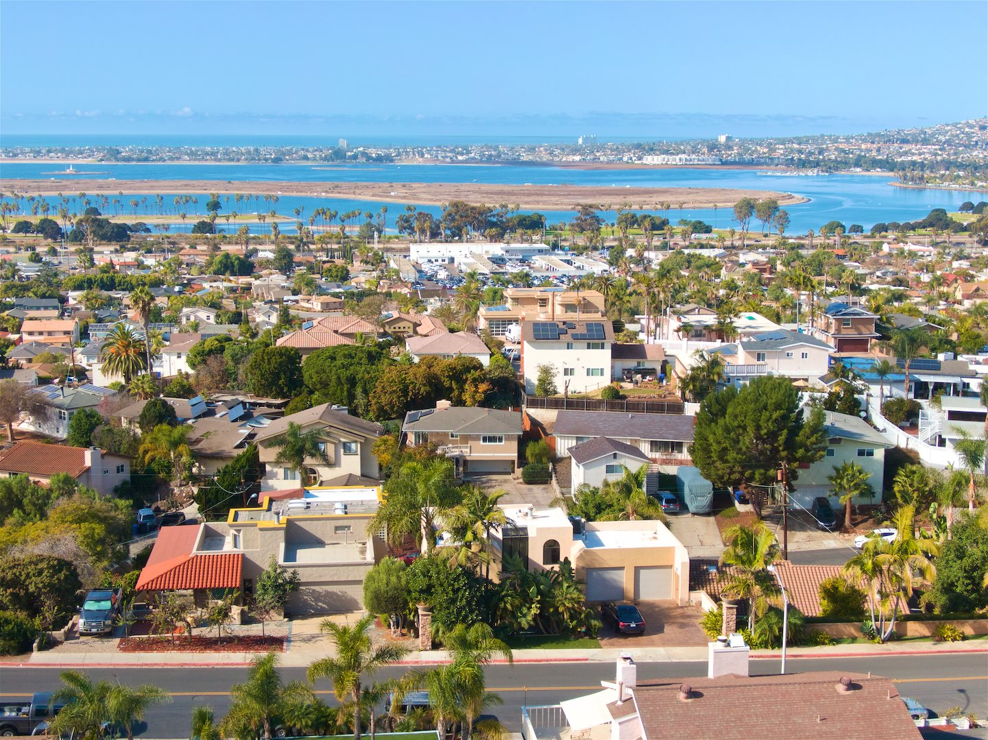 """AMAZING OPPORTUNITY! Essentially 3 homes on one of the most coveted streets in Bay Park. Panoramic Ocean/Bay & City Views, Recently Renovated Custom Built Main Home w/ """"sister home"""". Main home includes a master suite that occupies the entire top floor. The """"sister unit"""" can be combined with main home or occupied separately & includes its own kitchen, 3 beds & 1 bath. Detached is permitted brand new 2 bed, 1 bath ADU w/ a separate street entrance. Over 900 sf of decks - see 3d tour & supplemental below...https://my.matterport.com/show/?m=cbQi2eNEsjC&mls=1  The entire 3rd floor is master w/ walk in closet, remodeled bathroom, fireplace, large private patio with views! Home has  over 900 sqft of view decks. Well appointed back yard with lush tropical water tolerant landscaping and fire pit. The second level is the main living area with newer tile, newer carpet, fireplace, and large patio with views + built in bar b que. The main home has a 2 car garage off of Illion St with 2 parking spaces in driveway. The """"sister home"""" is attached to the main home with a staircase that separates them, which can be closed off an occupied separate or made continuous with the main home. The """"sister home"""" has its own kitchen, back yard access, 3 bedrooms and a full bath.   Down below off of Orten St the seller has added an ADU with 2 bedrooms and 1 bathroom with 3 off street parking spaces. Great location, close to beaches, freeways, retail, shopping, schools. Estimated rental income for main home is $8,000 per month and for adults $2,800. See attachments for Air B&B income projections."""