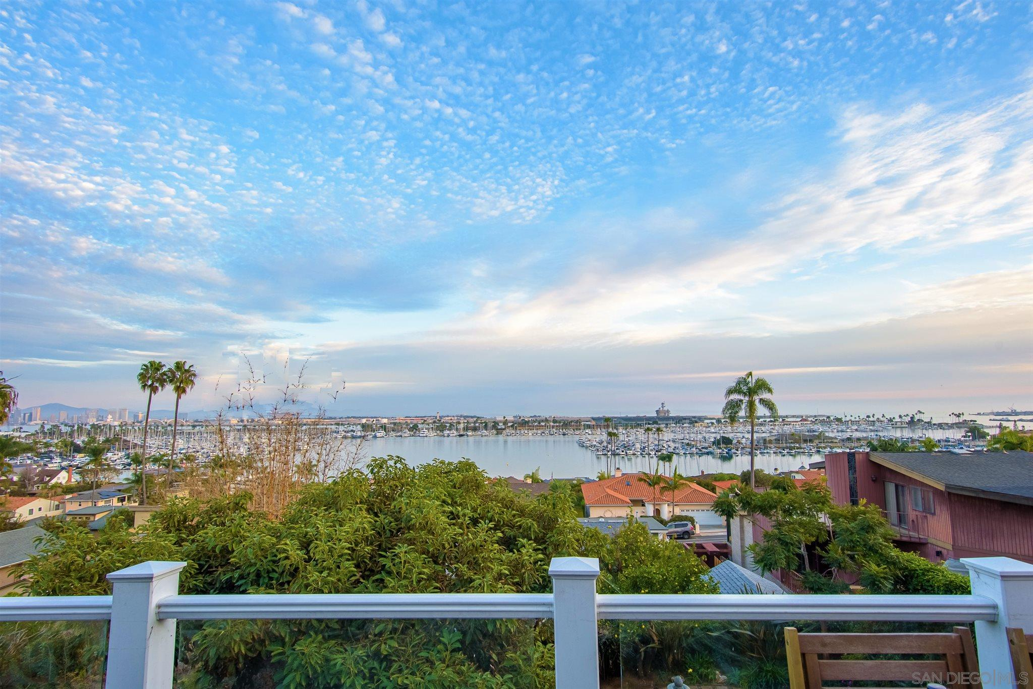 *Panoramic views from every level on the south side of Armada Terrace - the best in Point Loma. *Multiple outdoor spaces including 2 huge view balconies & spacious yard with outdoor kitchen, firepit & established fruit trees.  *Entertainers entry level kitchen, living spaces, dining room, breakfast nook and balcony. *Bessemer St & trail make an easy walk to harbor/SD Bay, beach, yacht clubs, Shelter Island & Point Loma Village restaurants & shops. *Views of harbor, SD city skyline, Coronado Islands & endless ocean all the way to Mexico.