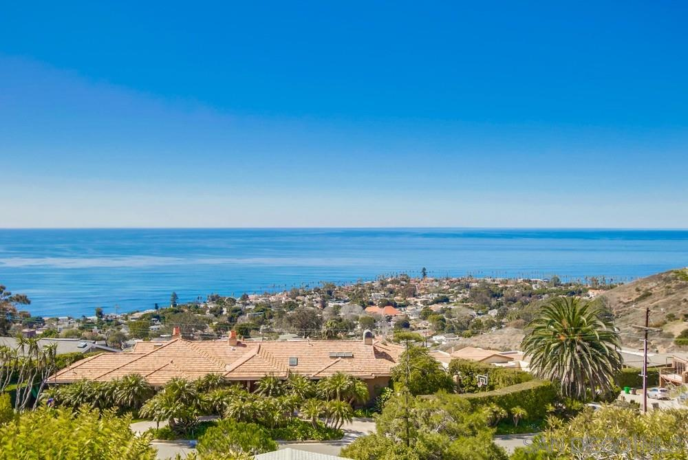 Phenomenal 180 degree ocean views abound from this Mid-Century gem nestled in the Muirlands. Expansive windows, tongue and groove ceilings, copper-clad fireplace and a beautiful yet efficient floor plan marries the best elements of form and function. The design also maximizes the expansive ocean views from nearly every room in the residence and integrates the outdoor living spaces and ample yard. A truly unique property and offering.