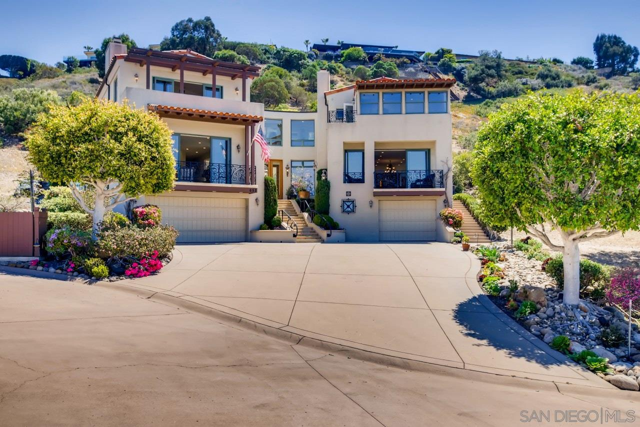 This grand, gorgeous custom ocean view residence at the foot of a protective terraced hillside rests on a serene cul-de-sac just blocks to La Jolla's most picturesque beach, Bird Rock and Village. Sweeping panoramic ocean and sunset views and bright clerestory windows create voluminous architectural drama while superb finish quality is evident throughout. With plenty of welcoming options for social gatherings and secluded retreats for study, (including a fantastic library lined with warm wood bookshelves and a circular stairway to a loft with additional built-ins,) this home was designed with all bedrooms en suite and enjoying view terraces. Expansive easy-care grounds feature lovely terraced gardens with private pool, patio and spa