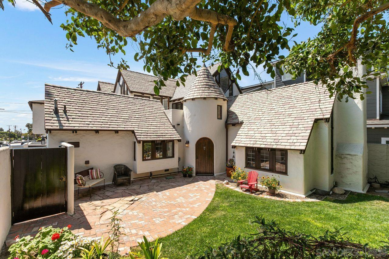 """Own a piece of La Jolla History in this 1928 charming """"Storybook"""" cottage behind a walled and gated entry. Located on a corner lot in prestigious """"La Jolla Shores"""" just steps away from a world class beach, restaurants & shops! Ten star location with no big streets to cross. Light filled home features modern updates while retaining it's old world charm. This 4 bedroom, 3 bath property features a main home that exudes charm with its beamed and cathedral ceilings and open floor plan. New kitchen features custom built cabinetry, stainless steel appliances, quartz counters & built-in banquette area. Wood burning fireplace. Composite slate tile roof, turret, copper weather vane & custom chimney cap add to the breathtaking curb appeal.Large master bedroom has office nook and private balcony. Two single car garages with a private one bedroom apartment above offers peak ocean & sunset views! Apartment is perfect for your home office, guests, nannies or rental income. It is zoned R-2. The carriage house/apartment over the garage is addressed as 2134 Paseo Dorado and has a separate gated entrance.  Property has two addresses but is one legal parcel zoned R-2. The carriage house/apartment is in the photo section under """"Other,"""" Click on """"Other"""" for details. Enjoy the private front yard and a private back yard/patio plus a putting green area. Charm exudes from this light filled happy home. Welcome to Paradise!"""