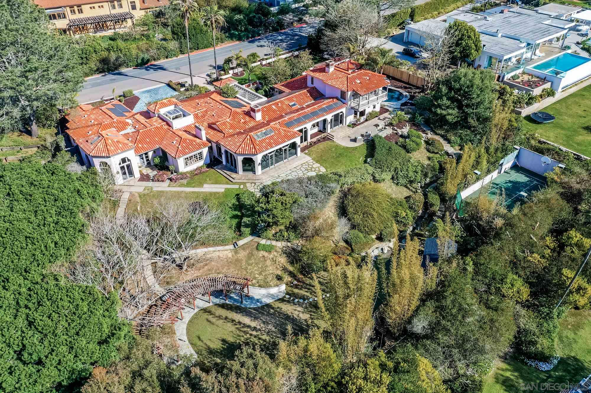 Entertaining $6,999,000- $7,499,000. Conveniently located just minutes from the beach, in the highly-sought after La Jolla Farms community, 9660 Black Gold Road is truly a stunning property.  Boasting gorgeous ocean views, this expansive estate offers the rare opportunity to live on a beautifully-landscaped acre lot, all while being within close proximity to the beach, shopping and fine dining! Featuring 6 bedrooms, 4.5 baths and over 6,900 sq ft of magnificent living spaces, on-premises sport court and extensive water features, designed by famous architect Don Edison.Entertain in the bright and open living room, with its elegant coffered ceilings, floor to ceiling windows that bathe the room in natural light, and a fireplace, perfect for creating a cozy ambiance while taking in the million dollar views. Expansive windows throughout the home bring the calming outdoor elements inside, offering spectacular views while creating a zen-like atmosphere. Prepare your favorite meal in the gourmet kitchen with its state of the art appliances, including a wine refrigerator or host a dinner party in the nearby dining room, where you can enjoy great food and company, while relishing the spectacular views. And with doors leading outside, you can easily take advantage of indoor/outdoor living!  Tantalizing ocean views take center stage in the master retreat, with a wall of French doors leading out to a patio, perfect for allowing the fresh coastal breezes to trickle in.  Unwind in the luxurious master bath, complete with a large soaking tub, walk-in shower and spacious walk in closet. With 5 additional bedrooms, as well as a wood-paneled office complete with custom built-ins and an oversized bonus room, perfect for a home gym or yoga studio, this home offers every amenity you need! Enjoy a five-star getaway experience in your very own backyard, complete with relaxing waterfalls,  a beautiful oversized swimming pool and a koi pond with shaded seating, where you can partake in your
