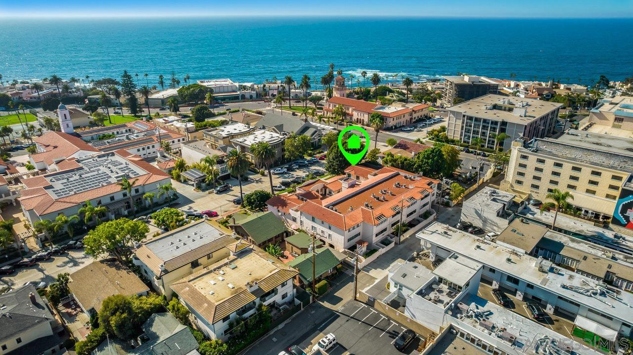 Rarely available top-floor condo in the gated La Flor Del La Jolla community. Located in an ideal location in the heart of The Village and within easy walking distance to all shopping, beaches, restaurants, parks, La Jolla Cove, nightlife, churches, schools, and many more! It is truly a walker's paradise! The top floor location within the community gives you the privacy of no neighbors above you and peek-a-boo views of the ocean.     This spacious 2 bedroom, 2 bath condo has been updated throughout and does not require anything besides a new owner. Upgrades include plantation shutters for maximum privacy, wet bar, LED lighting throughout, reversible Minka Air Fans, updated baths, and more. The nicely updated kitchen includes updated cabinets with self-closing drawers, granite countertops with marble backsplash, and stainless steel appliances. The large master bath features a walk-in shower, walk-in closet, and his/her sink vanities. The large patio off the back of the property is accessible from both bedrooms and has an additional storage closet. The property includes elevator access to the underground parking and 2 assigned side-by-side parking spaces with storage lockers. This home has been meticulously maintained and is move-in ready. 30-Day rentals are allowed and the low HOA covers water & trash.Rarely available top-floor condo in the gated La Flor Del La Jolla community. Located in an ideal location in the heart of The Village and within easy walking distance to all shopping, beaches, restaurants, parks, La Jolla Cove, nightlife, churches, schools, and many more! It is truly a walker's paradise! The top floor location within the community gives you the privacy of no neighbors above you and peek-a-boo views of the ocean.     This spacious 2 bedroom, 2 bath condo has been updated throughout and does not require anything besides a new owner. Upgrades include plantation shutters for maximum privacy, wet bar, LED lighting throughout, reversible Minka Air Fans, upda